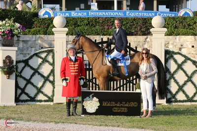 Charlie Jacobs and Flaming Star in their winning presentation with ringmaster Cliff Haines and Giovana Pirolo, Membership Coordinator at The Mar-a-Lago Club.